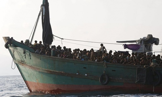 Migrant boat tethered to a Thai navy vessel, in waters near Koh Lipe island. Photograph: Olivia Harris/Reuters
